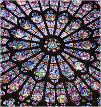 Religion is useful for some things, but we've outgrown the Holy Roman Empire dictating that the Earth is flat. We can thank the church for commissioning some lovely stained glass. This is one of the rose windows at Notre Dame Cathedral, Paris. Photo by Eric Francis.