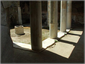 View of the interior of the temple of Hermes, the god of merchants, on the isle of Delos on the Aegean Sea. Archeological evidence suggests the building was probably also used as a fraternity or social club of some kind. Photo by Eric Francis.