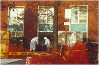 Hazardous materials workers outside dormitory at the State University of New York at New Paltz, January 1992. See photo tour for more info.