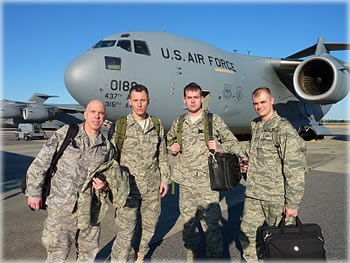 Four airmen of the Oregon Air National Guard, after arriving at the Port-au-Prince Airport in Haiti. From left to right: Master Sgt. Ken Campbell, Tech. Sgt. Michael Fischer, Staff Sgt. Matt Jenkins, and Lt. Mark Gibson.