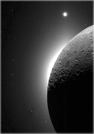 Venus is visible above Earths moon, which is illuminated solely by light reflected from Earth. Because of Venus nearness to Earth and the way its clouds reflect sunlight, it appears to be the brightest planet in the night sky. Photograph courtesy NASA.